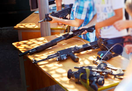 Youth plays with weapons in the museum of the history of war Stock Photo