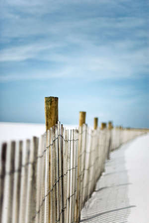 Short depth-of-field shot of a sand dunes fence at the beach