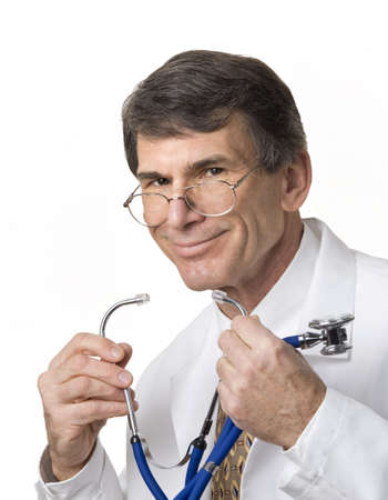 Closeup of friendly doctor removing his stethoscope, white background Stock Photo - 2514914