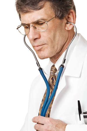 Caring Doctor listening through stethoscope. Closeup, isolated on white Stock Photo - 2553986