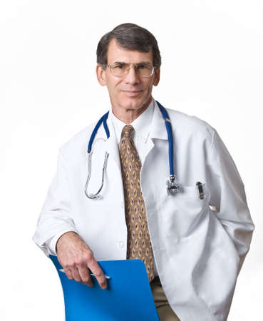 Kind looking doctor facing viewer, wearing lab coat, stethoscope, white background