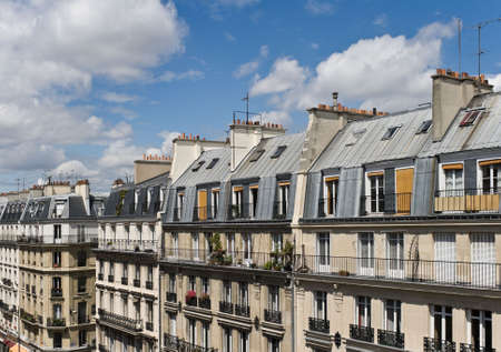 balcony: View of upper floors and rooftops of street and apartments in Paris in the Latin Quarter Stock Photo