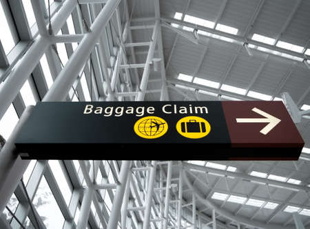 Interior view looking up at Baggage Claim direction sign at Seattle (Sea-Tac) airport Standard-Bild