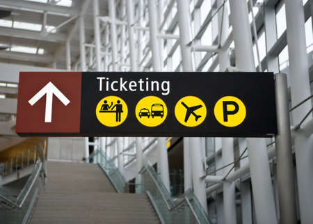 airports: Ticketing Sign in main terminal at Seattle (Sea-Tac) airport