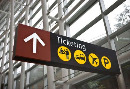 Inter of main terminal at Sea-Tac (Seattle) airport with closeup of ticketing direction sign Stock Photo - 3105511
