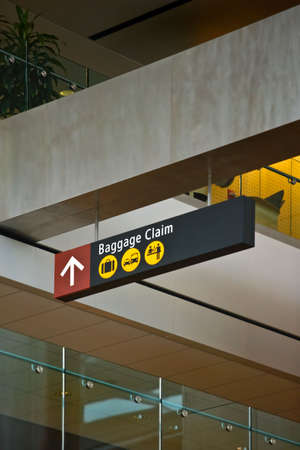 Baggage claim sign surrounded by interior architectural elements at Seattle (Sea-Tac) Airport Stock Photo - 3114559