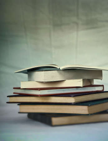 collectible: A stack of very old books, short depth of field, creative blurs