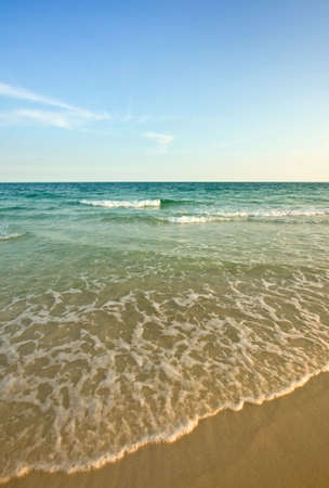 Waves gently rolling in on a calm colorful beach at dusk. Stock Photo - 3242259