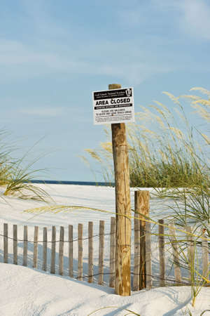 Keep Out sign at beach due to dunes restoration and recovery after a hurricane. Stock Photo - 3242258