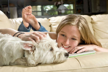 Portrait of a cute young woman enjoying quality time with her white West Highland Terrier, Jack