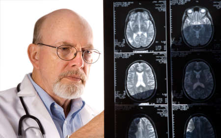 Doctor viewing MRI scans photo
