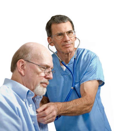 Male doctor or medical worker listening to senior male patients heart with stethoscope photo