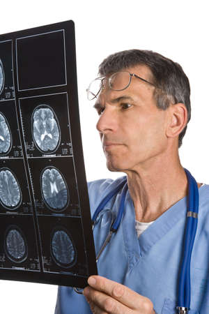 reviewing: Physician reading and reviewing a MRI brain scan