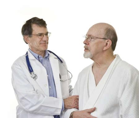 Compassionate doctor encouraging senior male patient photo