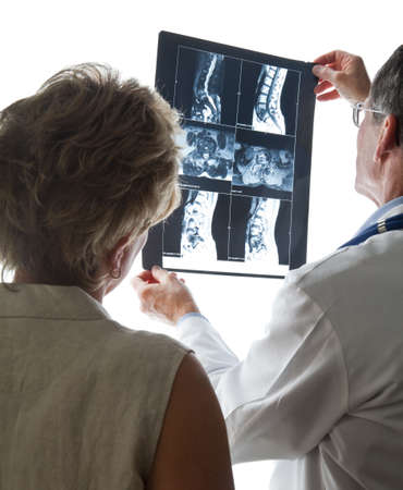 Doctor and Patient Discuss Back X-Rays