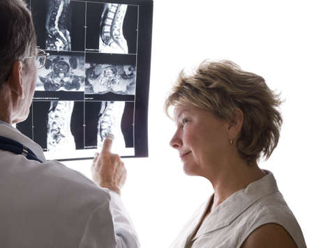 Doctor and Patient Discuss Back X-Rays photo