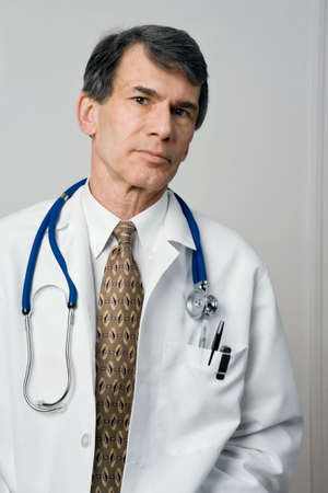Portrait of a medical doctor in labcoat with looking serious and sincere. Standard-Bild