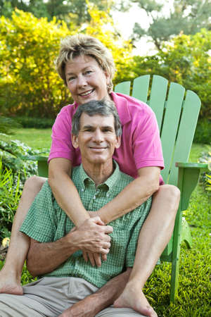 Happy, attractive, mature couple hugging and relaxing outdoors Stock Photo - 5259361