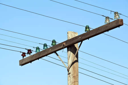 telephone poles: Old wooden telephone poles with glass insulators
