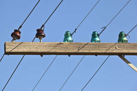 insulators: Closeup of old telephone pole with glass insulators