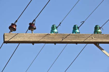 insulators: Closeup of old telephone pole with glass insulators