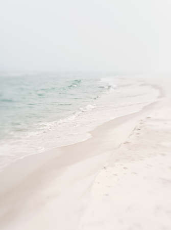 Atmospheric mood shot of the beach and ocean on a very misty, foggy day