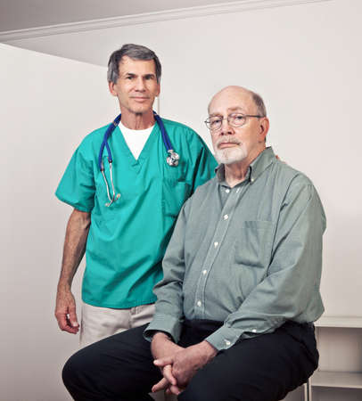 Male doctor or nurse with senior male patient. Doctor is smiling.