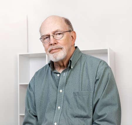 pleasant: Pleasant looking senior caucasian man closeup portrait.