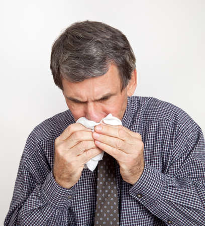 Man with Nosebleed or Blowing or Wiping Nose photo