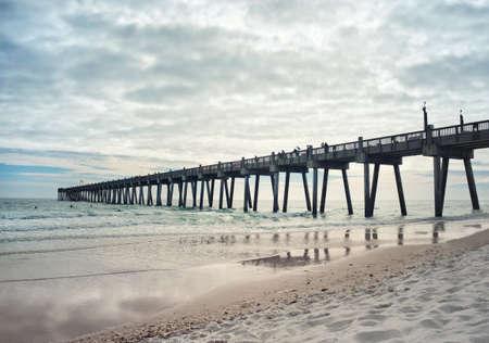 pensacola: Landscape shot of fishing pier at Pensacola Beach, Florida at sunset