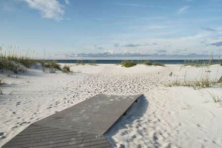 Beach boardwalk footpath meets the sand on beautiful Gulf Coast beach in the early morning  Zdjęcie Seryjne