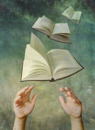 Photo illustration of child's hands reaching up for open books that are flying like birds in the sky. Reading enrichment and education concepts. Artistically textured with a vintage look.