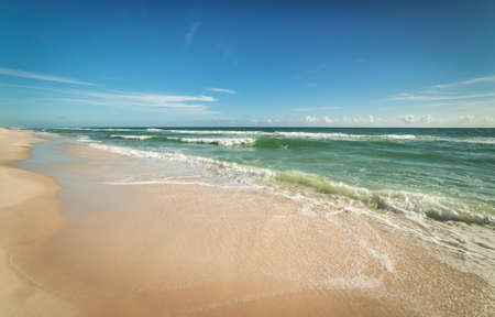 Wide angle view of sparkling waves and surf on a Florida beach on a sunny day Stock Photo