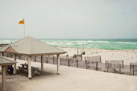 Beautiful beach sand dunes on a stormy day in Florida on the Gulf of Mexico with sand fences to prevent erosion.