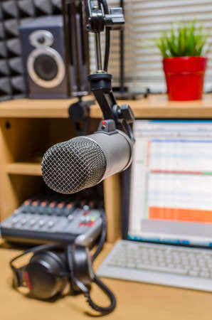 broadcasting: mic in front of the control panel in broadcasting studio Stock Photo
