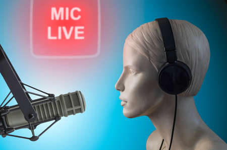 Mannequin in headphones at the microphone - announcer Stock Photo
