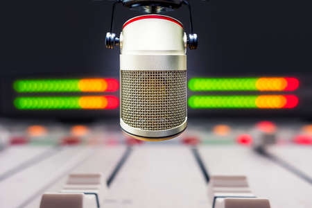 Professional microphone and sound mixer in radio station studio Stock Photo