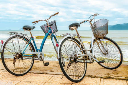 Two old bicycles on the sea coast