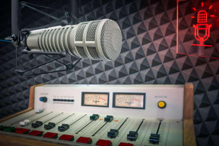 radio station studio: professional microphone and sound console Standard-Bild