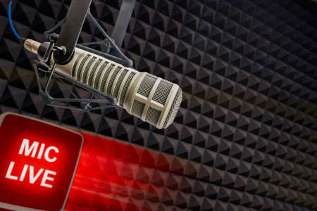 Background: Professional microphone and on air sign and copy space
