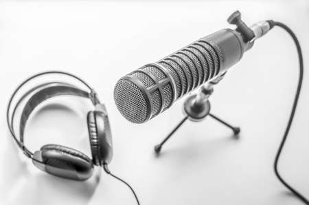 professional microphone and headphones on a white background