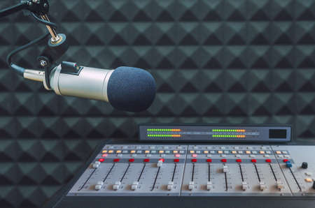 Professional microphone and sound mixer in radio station studio Standard-Bild