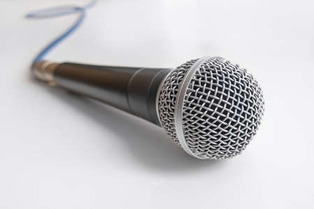microphone with blue cable on white table