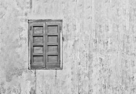 background: wall and window closed with shutters Stock Photo