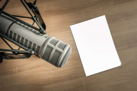 Professional microphone and blank sheet of paper