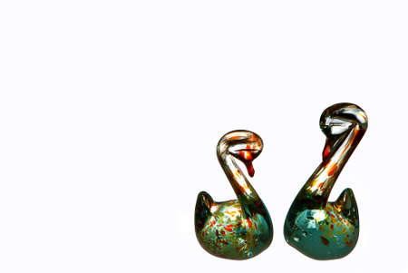 statuettes: Couple of swan statuettes made of colored glass isolated on white with copy space