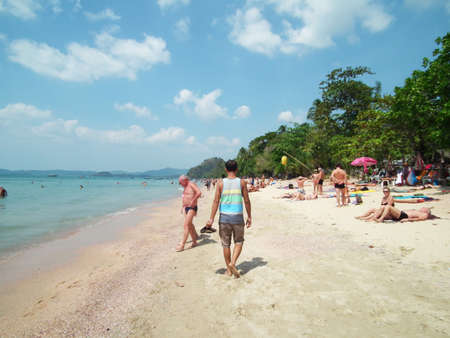 Tourists sunbathing on the beach in Krabi, Thailand