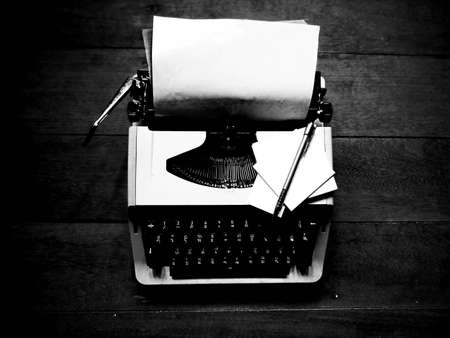 Vintage typewriter with note paper photo