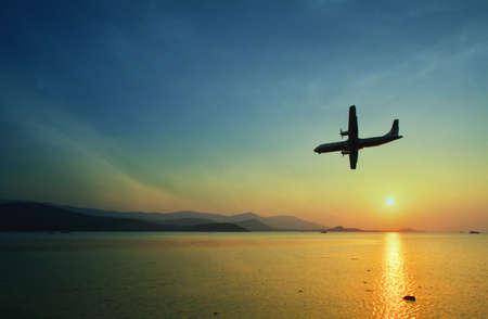 tweet balloon: Beatiful sunset  background and airplane Stock Photo