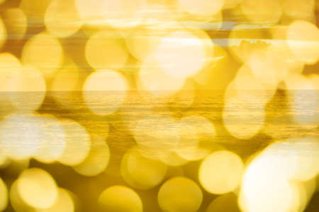 golden sea  in with bokeh ligh abstract summer  background Stock Photo
